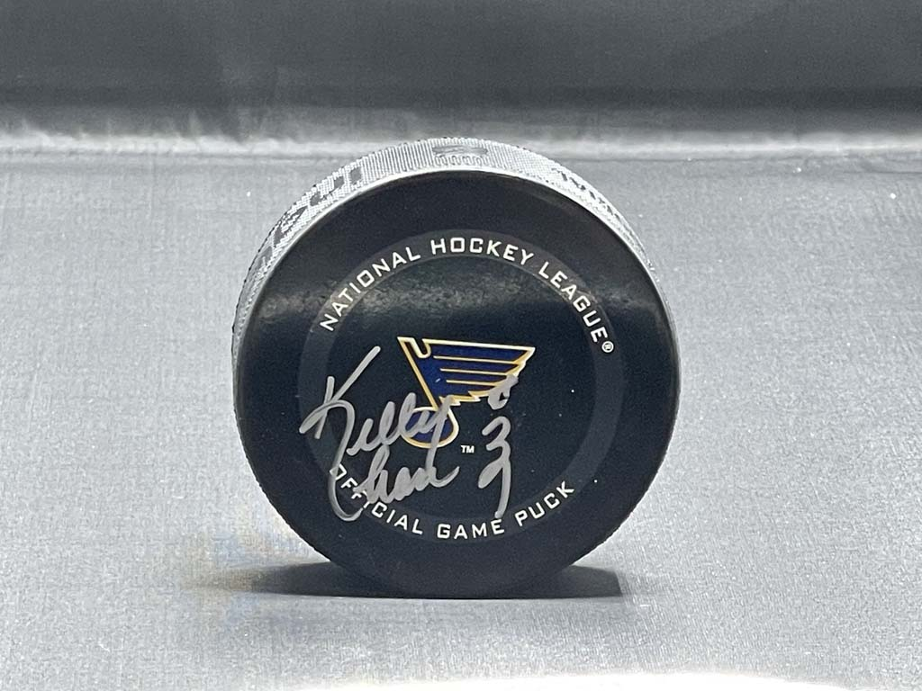 Kelly Chase Puck/Book Autographed